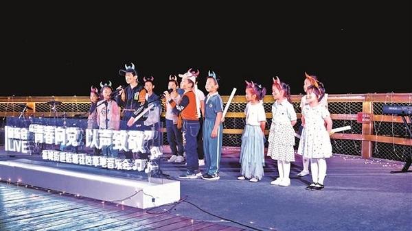福城桔塘社区草地音乐会唱出爱党爱国之情